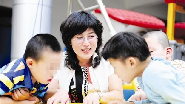 甘井子区特殊教育中心校长董欣 用爱撑起他们的明天
