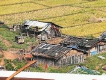 西双版纳勐腊县茅草山村旧貌换新颜