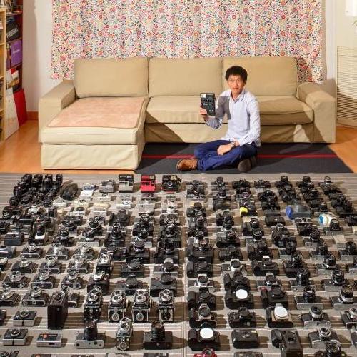 80后小伙收藏相机数百台